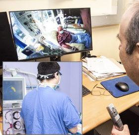 A medical expert watching live video of a patient on his computer