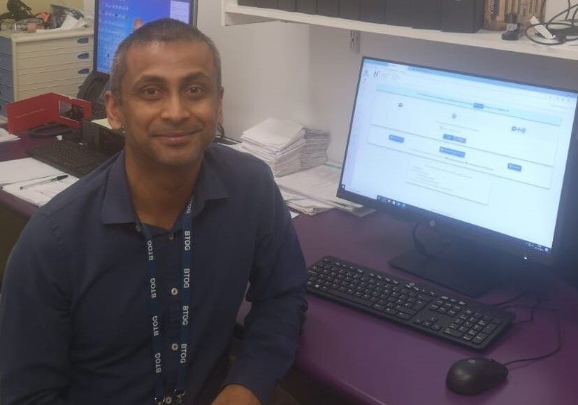 Dr Parthiban Nadarajan at his workstation with BlueEye Clinic platform open on his system