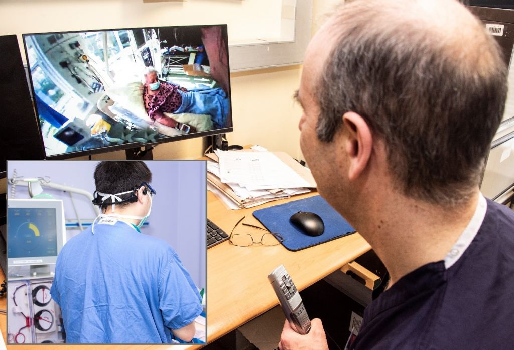 Medical expert watching a computer screen with video captured by BlueEye Handsfree